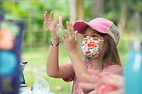 Avery Hyman, 8, makes a caterpillar out of modeling clay during Butterfly Day Camp Tuesday Aug. 3, 2021 at the Botanical Garden of the Ozarks in Fayetteville. Areas of study include habitat, life cycles, coloration and defense and butterfly behaviors. The camp goes until Aug. 6th. For more information about activities at the garden see https://www.bgozarks.org/. Visit nwaonline.com/21000804Daily/ and nwadg.com/photo. (NWA Democrat-Gazette/J.T. Wampler)