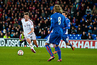 Wednesday 05 March 2014<br /> Pictured: Emyr Hughes ( left ) makes a run with the ball <br /> Re: International friendly Wales v Iceland at the Cardiff City Stadium, Cardiff,Wales UK