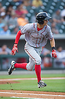 Trea Turner (7) of the Syracuse Chiefs hustles down the first base line against the Charlotte Knights at BB&T BallPark on June 1, 2016 in Charlotte, North Carolina.  The Knights defeated the Chiefs 5-3.  (Brian Westerholt/Four Seam Images)
