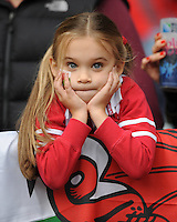A young Welsh fan looks on during Match 35 of the Rugby World Cup 2015 between Australia and Wales - 10/10/2015 - Twickenham Stadium, London<br /> Mandatory Credit: Rob Munro/Stewart Communications