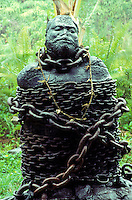 Lava sculpture of Hawaiian in bondage/chains in Puna on the Big Island of Hawaii.