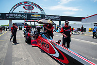 Jul 11, 2020; Clermont, Indiana, USA; Crew members with NHRA top fuel driver Steve Torrence during qualifying for the E3 Spark Plugs Nationals at Lucas Oil Raceway. This is the first race back for NHRA since the start of the COVID-19 global pandemic. Mandatory Credit: Mark J. Rebilas-USA TODAY Sports