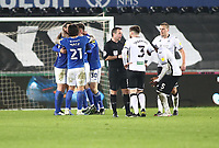 20th March 2021; Liberty Stadium, Swansea, Glamorgan, Wales; English Football League Championship Football, Swansea City versus Cardiff City; Cardiff City players celebrate the 0-1 win whilst Swansea City players appeal to Referee Paul Tierney