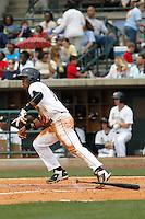 Charleston RiverDogs infielder Abiatal Avelino (19) during a game against the Augusta GreenJackets at Joseph P.Riley Jr. Ballpark on April 15, 2015 in Charleston, South Carolina. Charleston defeated Augusta 8-0. (Robert Gurganus/Four Seam Images)