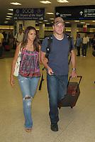 MIAMI - JULY 22: Actor Matt Damon and his wife Luciana Barroso arrive at Miami International Airport on July 22, 2009 in Miami, Florida<br /> <br /> <br /> People:  Matt Damon, Luciana Barroso