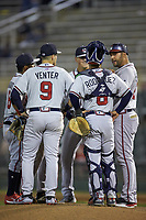 Rome Braves manager Matt Tuiasosopo (right) has a meeting on the mound during the game against the Kannapolis Intimidators at Kannapolis Intimidators Stadium on April 4, 2019 in Kannapolis, North Carolina.  The Braves defeated the Intimidators 9-1. (Brian Westerholt/Four Seam Images)