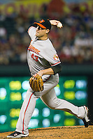 Baltimore Orioles pitcher Jim Johnson #43 delivers during the Major League Baseball game against the Texas Rangers on August 21st, 2012 at the Rangers Ballpark in Arlington, Texas. The Orioles defeated the Rangers 5-3. (Andrew Woolley/Four Seam Images).