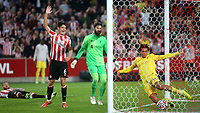 Liverpool's Trent Alexander-Arnold is unable to stop the ball crossing the line and Brentford's Christian Norgaard celebrates their second goal scored by Vitaly Janelt during Brentford vs Liverpool, Premier League Football at the Brentford Community Stadium on 25th September 2021
