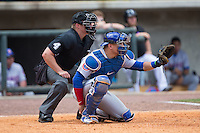 Tennessee Smokies catcher Kyle Schwarber (12) sets a target as home plate umpire Garrett Patterson looks on during the game against the Birmingham Barons at Regions Field on May 4, 2015 in Birmingham, Alabama.  The Barons defeated the Smokies 4-3 in 13 innings. (Brian Westerholt/Four Seam Images)