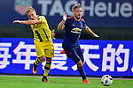 Manchester United defender Luke Shaw (r) fights for the ball with Borussia Dortmund midfielder Felix Passlack (l) during the International Champions Cup China 2016, match between Manchester United vs Borussia  Dortmund on 22 July 2016 held at the Shanghai Stadium in Shanghai, China. Photo by Marcio Machado / Power Sport Images
