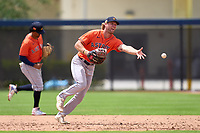 Houston Astros first baseman Zach Biermann (76) flips the ball to the pitcher covering the bag during a Minor League Spring Training game against the New York Mets on April 27, 2021 at FITTEAM Ballpark of the Palm Beaches in Palm Beach, Fla.  (Mike Janes/Four Seam Images)