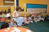 MR / Abingdon, Oxfordshire, England.Thomas Reade Primary School.Foundation Class for ages 3-5 .Teacher leads class group as students sing and clap hands together..(Ages 3-4 attend this class half-day, age 5 attends full-day).©Ellen B. Senisi
