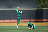 Notre Dame Fighting Irish center fielder Spencer Myers (2) jumps for a ball that fell just out of the reach of shortstop Jared Miller (16) during the game against the Wake Forest Demon Deacons at David F. Couch Ballpark on March 10, 2019 in  Winston-Salem, North Carolina. The Demon Deacons defeated the Fighting Irish 7-4 in game one of a double-header.  (Brian Westerholt/Four Seam Images)