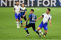 Lautaro Martinez of FC Internazionale and Maya Yoshida of Sampdoria compete for the ball during the Serie A football match between FC Internazionale and UC Sampdoria at Stadio San Siro in Milano ( Italy ), June 21th, 2020. Play resumes behind closed doors following the outbreak of the coronavirus disease. <br /> Photo Image/Insidefoto
