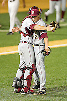 Florida State Seminoles relief pitcher Robert Benincasa #22 is congratulated by catcher Stephen McGee #9 after getting the final out against the Wake Forest Demon Deacons at Wake Forest Baseball Park on March 24, 2012 in Winston-Salem, North Carolina.  The Seminoles defeated the Demon Deacons 3-2.  (Brian Westerholt/Four Seam Images)