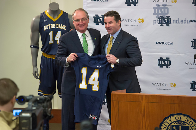 Jan. 21, 2014; University Vice President and Director of Athletics Jack Swarbrick poses for photos with Kevin Plank, Under Armour Founder and CEO at a press conference where Notre Dame and Under Armour announced a partnership for Under Armour to serve as Notre Dame's exclusive performance footwear and apparel supplier.<br /> <br /> Photo by Matt Cashore/University of Notre Dame