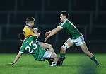 Aidan Davison of Clare  in action against Josh Lyons and Cormac Flanagan of Limerick during the Mc Nulty Cup U-21 final at The Gaelic Grounds. Photograph by John Kelly.