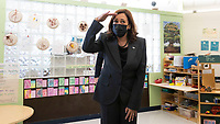 United States Vice President Kamala Harris pretends to look for a child hiding under a table in a classroom during a visit to the Ben Samuels Children's Center at Montclair State University in Little Falls, New Jersey, USA, 08 October 2021. Harris and Murphy also participated in a roundtable discussion about about federal investment in childcare.<br /> CAP/MPI/RS<br /> ©RS/MPI/Capital Pictures