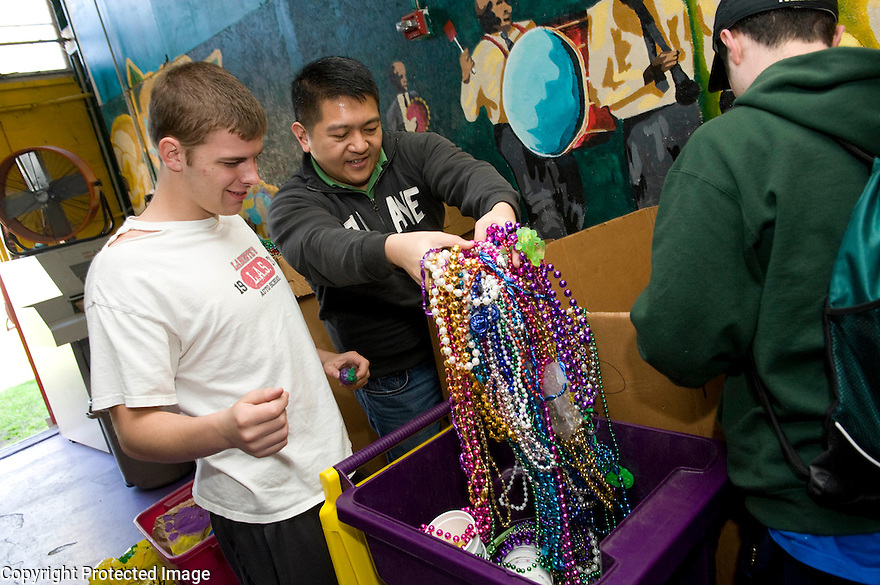 Tulane students and faculty volunteer at the ARC, sorting beads.