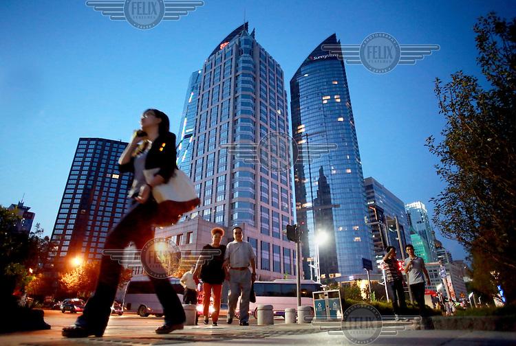 A woman walks through downtown Qingdao.