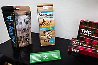 """Switzerland. Canton Grisons. Cama. CBD Logistics is a  shop selling various cannabis CBD and hemp products. Dog food with CBD. Dry biscuits, such as """"CanaBones"""" and """"Paw Treats for Love and Vitality"""". A THC presumptive drug identification field testing kit. The business of selling cannabis CBD is registered with the Swiss Federal Health Office. The Swiss legal requirements have a 1 percent THC limit compare to the European Union (EU) where the THC limit is limited to 0.3 percent. Cannabidiol (CBD) is a phytocannabinoid discovered in 1940. It is one of some 113 identified cannabinoids in cannabis plants and accounts for up to 40% of the plant's extract. Cannabidiol can be taken into the body in multiple ways, including by inhalation of cannabis smoke or vapor, as an aerosol spray into the cheek, and by mouth. It may be supplied as CBD oil containing only CBD as the active ingredient (no included tetrahydrocannabinol [THC] or terpenes), a full-plant CBD-dominant hemp extract oil, capsules, dried cannabis, or as a prescription liquid solution. 24.07.2019 © 2019 Didier Ruef"""
