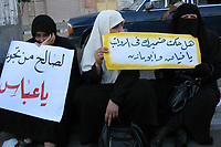 """THree women STAGE SIT and sat on the floor in protest at not receiving their salaries, demanding the Palestinian President Mahmoud Abbas and Prime Minister Salam Fayyad extradite paid July 12, 2007 .""""photo by Fady Adwan"""""""