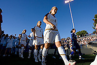 Lindsay Tarpley (5) and Cat Whitehill (4) lead the team onto the field. USA defeated Japan 4-1 at Spartan Stadium in San Jose, CA on July 28, 2007.