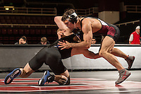 STANFORD, CA - January 18, 2015: Jim Wilson of the Stanford Cardinal wrestling team competes during a meet against Air Force Falcons at Maples Pavilion. Stanford won 27-8.