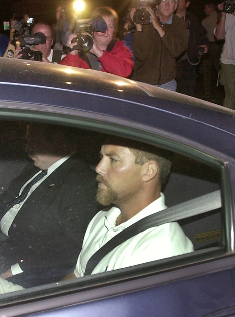 Scott Peterson arrives at the Stanislaus County Jail in Modesto, Calif., from San Diego late Friday, April 19, 2003 after he was arrested in the death of his wife, Laci, who was eight months pregnant when she vanished on Christmas Eve. The arrest came as authorities confirmed that two bodies that washed ashore this week were those of Laci and her baby. (AP Photo/Paul Sakuma)