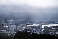 Fog lifts from the Wellington CBD during lockdown for the COVID19 pandemic in Wellington, New Zealand on Friday, 3 April 2020. Photo: Dave Lintott / lintottphoto.co.nz