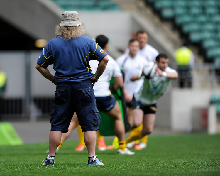 Laurie Fisher, Brumbies Forwards Coach, keeps an eye as  the Brumbies warm up during the World Club 7s at Twickenham on Sunday 18th August 2013 (Photo by Rob Munro)