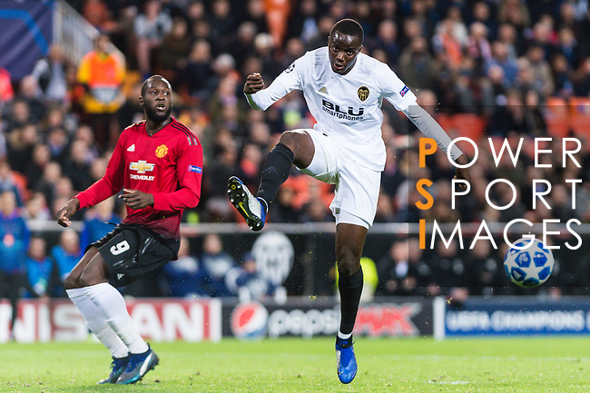 Romelu Lukaku of Manchester United (L) in action against Mouctar Diakhaby of Valencia CF (R) during the UEFA Champions League 2018-19 match between Valencia CF and Manchester United at Estadio de Mestalla on December 12 2018 in Valencia, Spain. Photo by Maria Jose Segovia Carmona / Power Sport Images