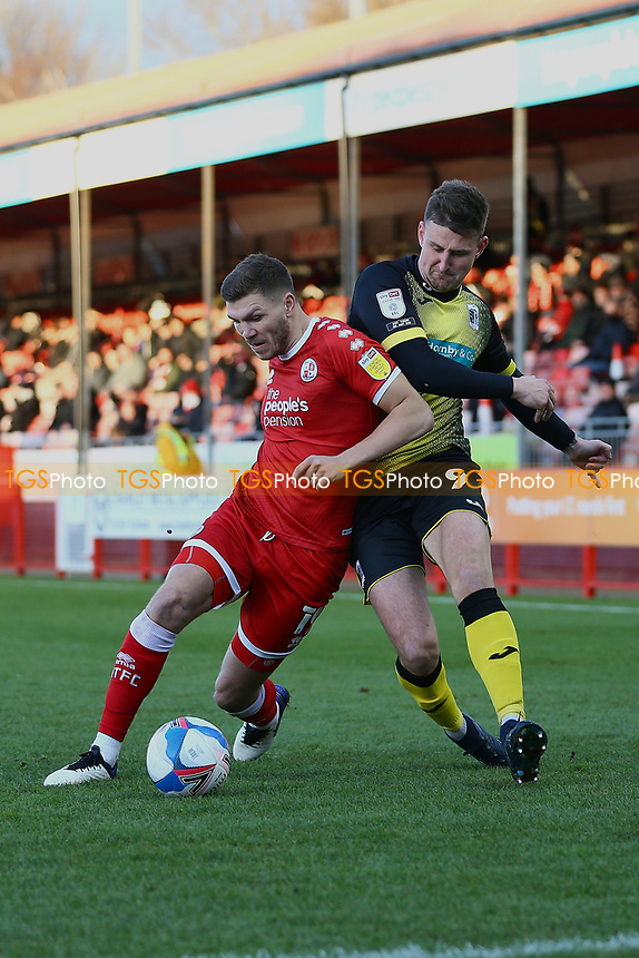 Jordan Tunnicliffe of Crawley Town and Scott Quigley of Barrow AFC during Crawley Town vs Barrow, Sky Bet EFL League 2 Football at Broadfield Stadium on 12th December 2020