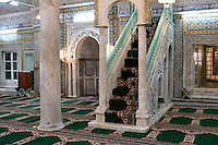 Tripoli, Libya - Gurgi Mosque, Tripoli Medina, showing mihrab (niche facing Mecca)  and minbar (pulpit).  Tunisian Tiles.  19th. century.  Last Tripoli mosque built during Turkish rule.