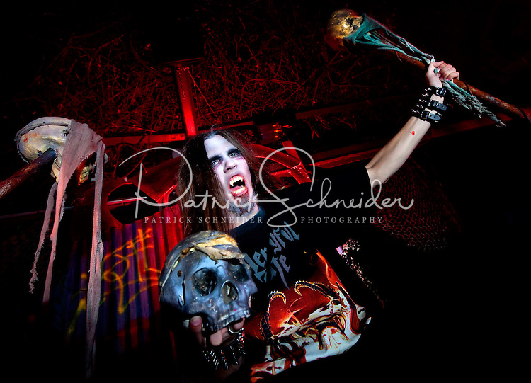 Charlotte's Carowinds theme park transforms itself each fall into SCarowinds, a haunted theme park with nightmarish scenes and attractions. The Scarowinds Halloween Haunt is rated PG-13. Photos are not model released, but were taken with permission by Carowinds.