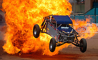 I.fair.1.0624.jl.jpg/photo Jamie Scott Lytle/A dunn buggy flies through a fire ball during the movie stunt show held at the San Diego County Fair Thursday afternoon. Motorcycles racing around, hosages, explosisions entertained the crowd in the Mad Max style show.