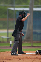 Umpire Alex Lawrie calls a strike during a Gulf Coast League game between the GCL Marlins and GCL Mets on August 11, 2019 at St. Lucie Sports Complex in St. Lucie, Florida.  GCL Marlins defeated the GCL Mets 3-2 in the second game of a doubleheader.  (Mike Janes/Four Seam Images)
