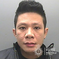 "Pictured: Vu Phung Luu<br /> Re: The ringleaders of a Vietnamese crime gang have been jailed after police seized 2.5 tonnes of cannabis worth about £6m in raids across south Wales.<br /> A total of 21 people have been sentenced in a case going back to 2017 after dozens of cannabis factories were uncovered across the region and beyond.<br /> One of the defendants initially claimed to be 14 years old, but police proved he was actually aged 26.<br /> The gang leaders were sentenced at Merthyr Tydfil Crown Court on Friday.<br /> Bang Xuan Luong, 44, was sentenced to eight years in prison. His partner, 42-year-old Vu Thi Thu Thuy, was jailed for six years and Tuan Anh Pham, 20, who was described in court as the ""IT Man"", received five years.<br /> An investigation into a cannabis factory in the Cynon Valley led officers from South Wales Police's Force Intelligence and Organised Crime Unit (FIOCU) to a string of others across south Wales, Gwent and Dyfed-Powys force areas."