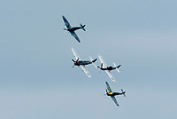 BNPS.co.uk (01202 558833)<br /> Pic: Graham Hunt/BNPS<br /> Date: 2nd September 2021.<br /> <br /> The Ultimate War Birds Flights consisting of the Buchon, Supermarine Spitfire, P-47D Thunderbolt and TF-51D Mustang performing their display on day 1 of Bournemouth Air Festival in Dorset on a warm overcast day.
