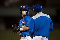 AZL Cubs shortstop Levi Jordan (4) talks to the first base coach during an Arizona League game against the AZL Brewers at Sloan Park on June 29, 2018 in Mesa, Arizona. The AZL Cubs 1 defeated the AZL Brewers 7-1. (Zachary Lucy/Four Seam Images)
