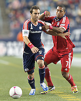 New England Revolution defender AJ Soares (5) brings the ball forward as Chicago Fire forward Sherjill MacDonald (7) defends. In a Major League Soccer (MLS) match, the New England Revolution (blue) defeated Chicago Fire (red), 1-0, at Gillette Stadium on October 20, 2012.