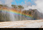 Rainbow behind Old Faithful Geyser, Upper Geyser Basin, Yellowstone National Park, Wyoming