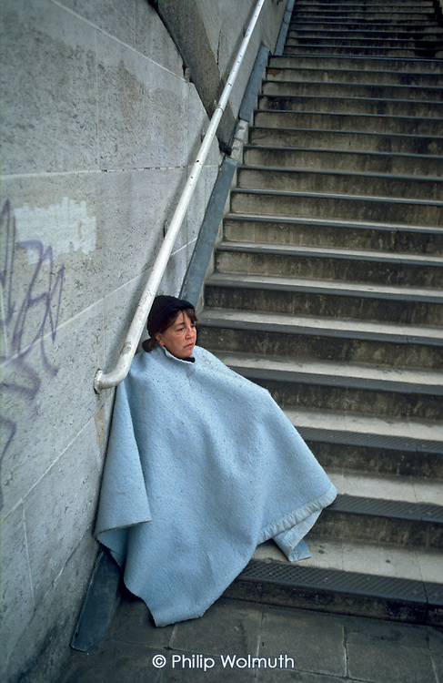 Homeless woman begging in central London