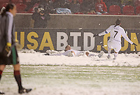 USA's Abby Wambach (C) and Shannon Boxx (R) make snow angels after Wambach scored a goal against Mexico's Erika Vanegas (L) at Rio Tinto Stadium March 31, 2010 in Salt Lake City, Utah. The USA women won the match over Mexico 1-0.