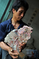 Mr Yang, manager from the Yun Chang Ping mercury mine holds a piece of mercury mined from deep with-in the mountains about 30 kilometers from Tongren city, Guizhou, China.