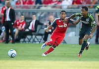Seattle Sounders FC defender James Riley #7 and Toronto FC forward Joao Plata #7 in action during an MLS game between the Seattle Sounders FC and the Toronto FC at BMO Field in Toronto on June 18, 2011..The Seattle Sounders FC won 1-0.