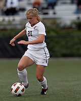 Harvard University midfielder Lauren Urke (20) dribbles at midfield. In overtime, Harvard University defeated Yale University,1-0, at Soldiers Field Soccer Stadium, on September 29, 2012.
