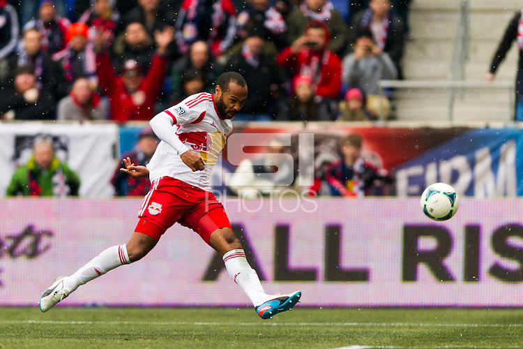 Thierry Henry (14) of the New York Red Bulls takes a shot. The New York Red Bulls and D. C. United played to a 0-0 tie during a Major League Soccer (MLS) match at Red Bull Arena in Harrison, NJ, on March 16, 2013.