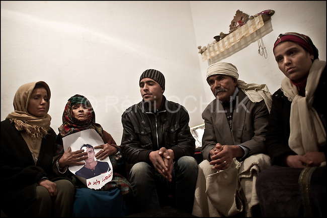 © Remi OCHLIK/IP3 -  Kasserine Tunisia - Saturday 24 January - Members of Walid Griri familly mourn their chlid, the 27 years old boy had been killed by a snipper january 10, 2011..The 6 january 2011 a desperate young man  unemployed from set himself on fier in front of the rail way station of Kasserine. Next days demonstrations and riots took place in the citie. Policemen and police snipers  killed 56 protesters.