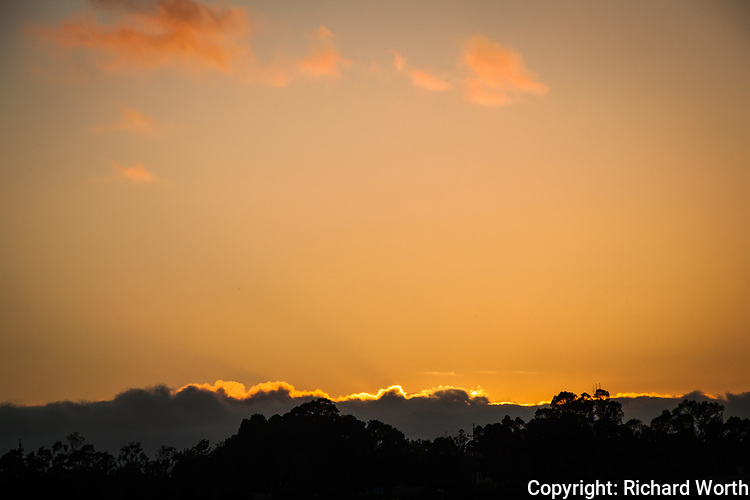 With sunset glow, the clouds on the horizon signal the coming weather shift from clear skies to clouds and maybe more.